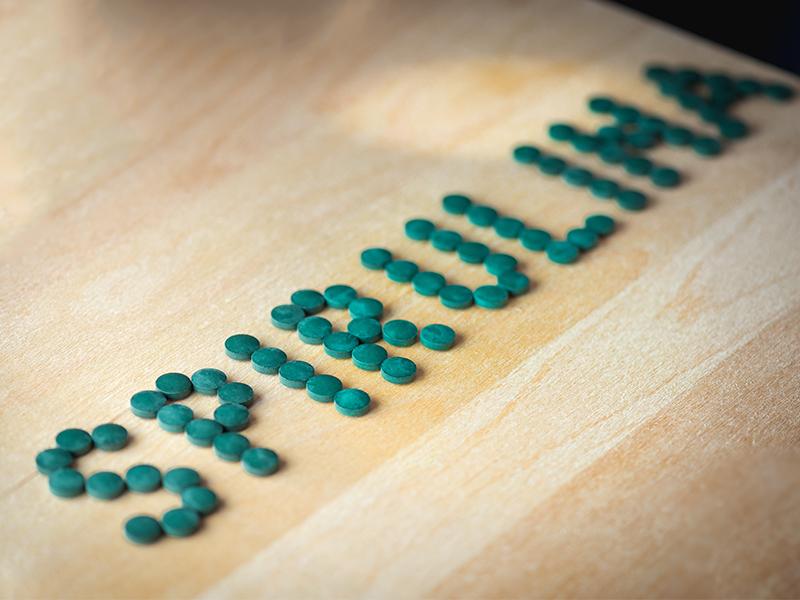 spirulina tablets on desk